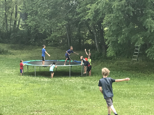 "Boys + trampoline + water hose = just one of the fun #SummerFunDay activities. (And I don't want to hear anything about nets and danger, this was ""fun mom"" approved)"